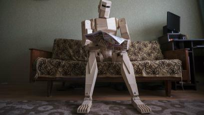 Robot with newspaper