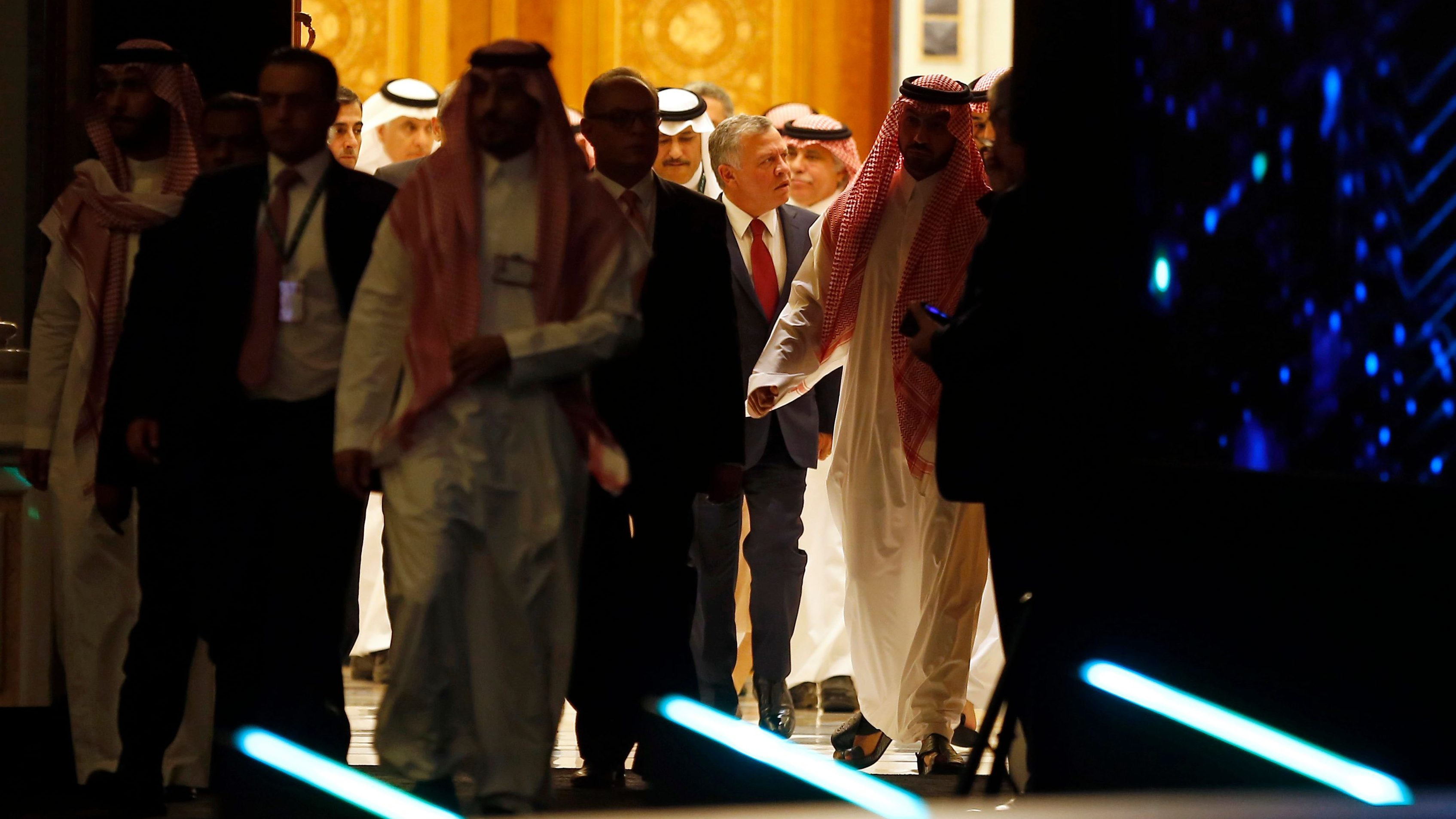 Jordan's King Abdullah II, center, enters the Future Investment Initiative conference hall, in Riyadh, Saudi Arabia, Tuesday, Oct. 23, 2018. The high-profile economic forum in Saudi Arabia is the kingdom's first major event on the world stage since the killing of writer Jamal Khashoggi at the Saudi Consulate in Istanbul earlier this month. (AP Photo/Amr Nabil)