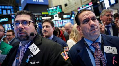 Traders work on the floor of the New York Stock Exchange (NYSE) in New York, U.S., October 12, 2018.
