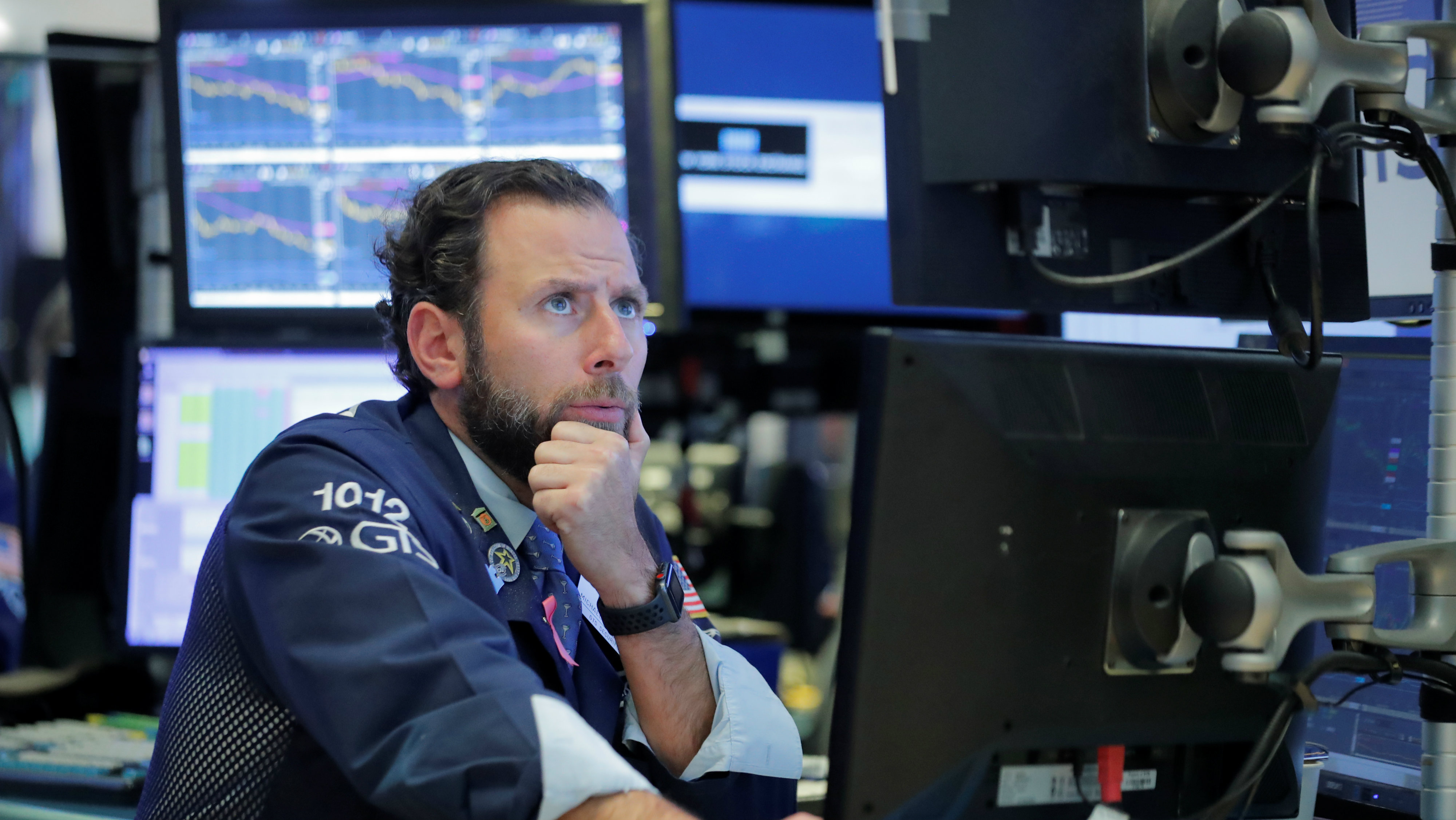A trader works on the floor of the New York Stock Exchange (NYSE) in Manhattan