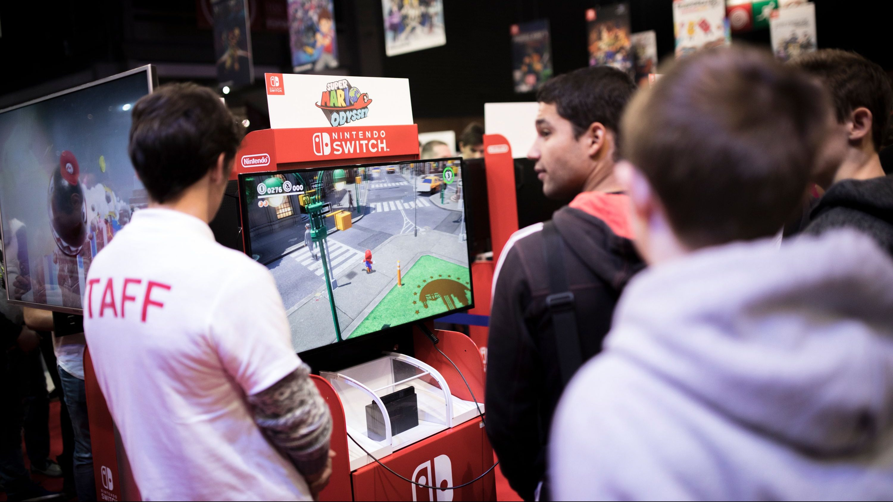 "Visitors play Mario Odyssey video game at the Nintendo stand at the Paris Games Week in Paris, Friday, Nov. 3, 2017. The Paris Games Week, or more commonly called ""PGW"" is the French show dedicated to video games and its derivatives.(AP Photo/Kamil Zihnioglu)"