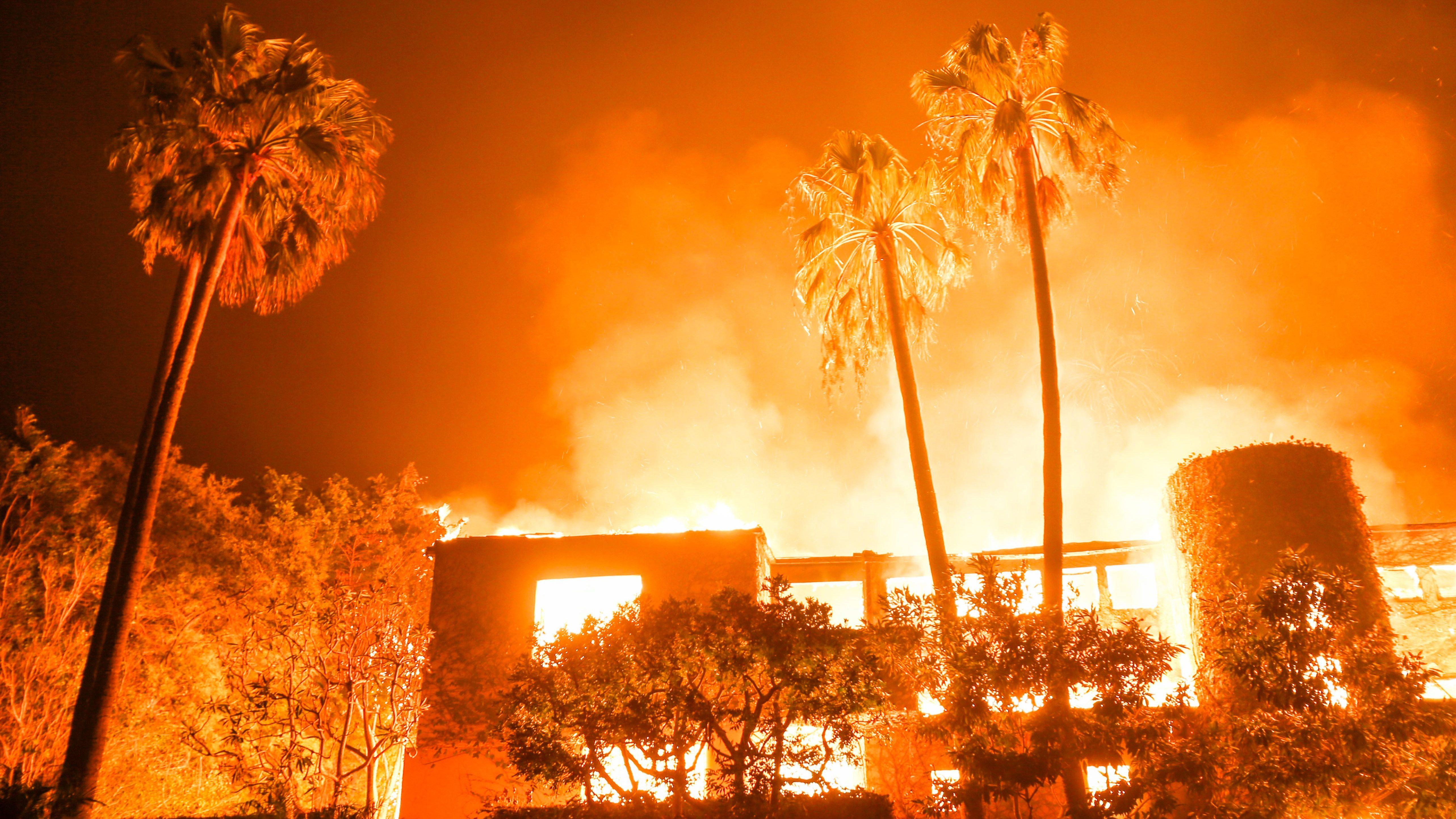 The Woolsey fire burns homes in Malibu, Calif., Friday, Nov. 9, 2018.