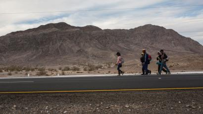 Central American migrants from Honduras, part of the Central American migrant caravan, walk along the highway that connects Mexicali with Tijuana