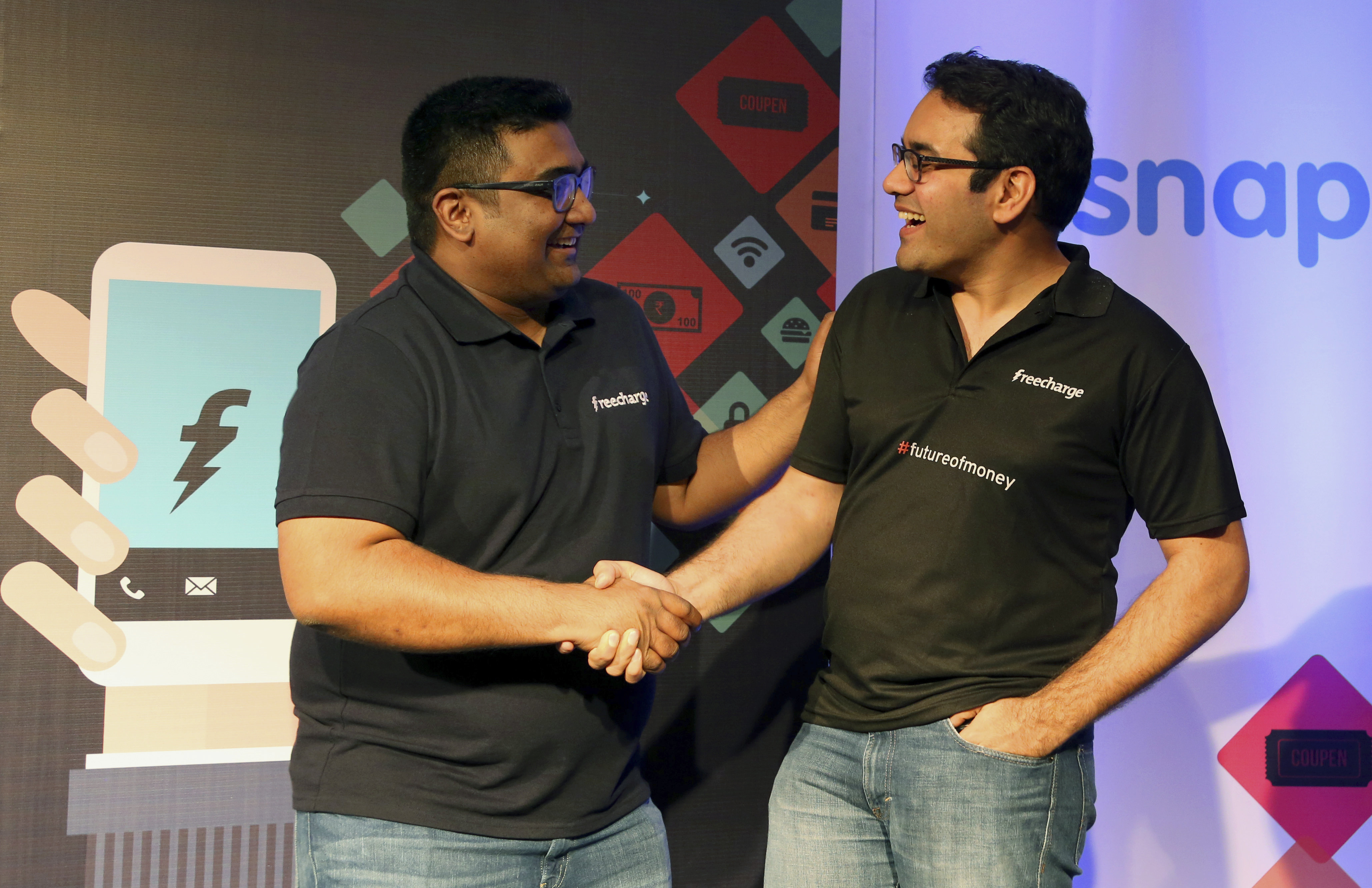 Kunal Bahl, right, co-founder and Chief Executive Officer (CEO) of Snapdeal and Kunal Shah co-founder and CEO of FreeCharge share a laugh after the launch of Digital Wallet in Bangalore, India