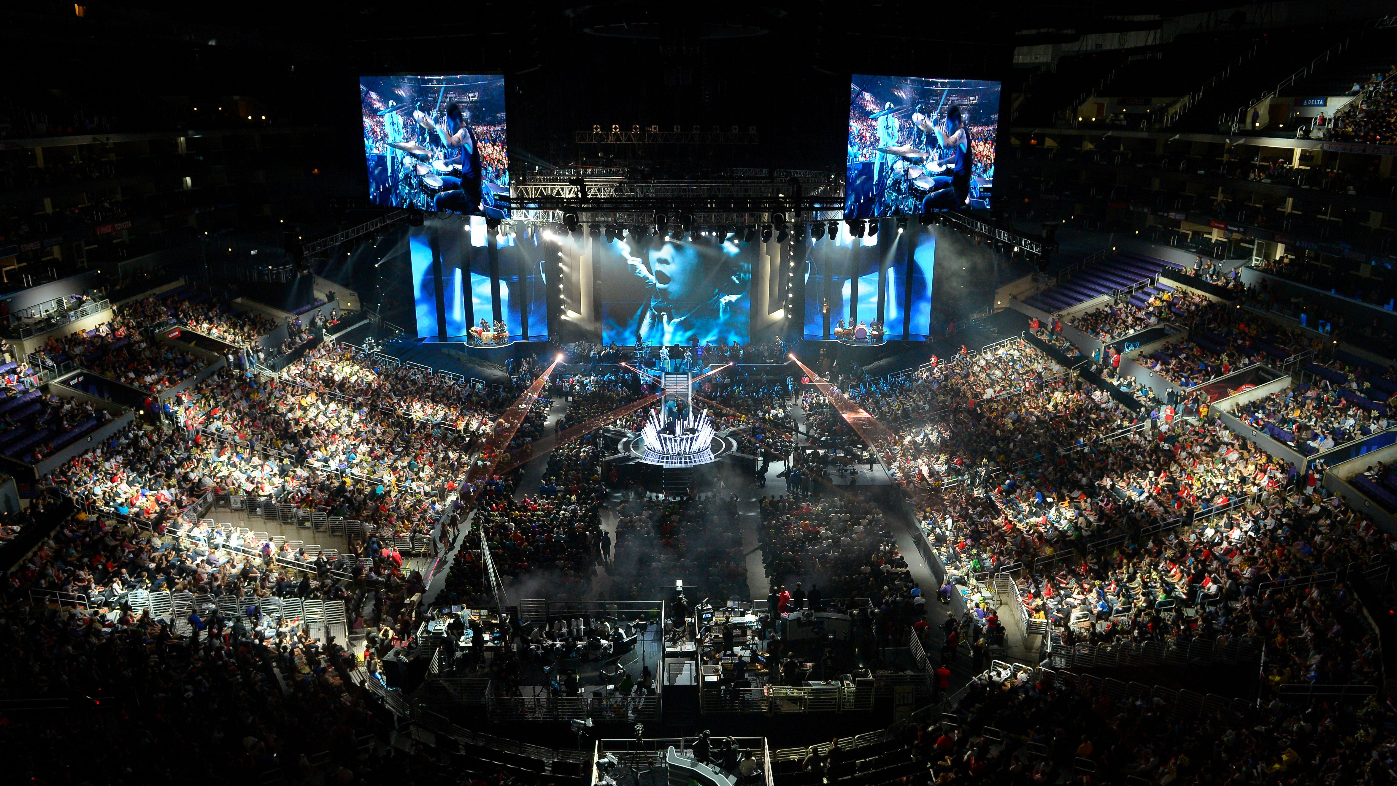 """FILE - In this Oct. 4, 2013 file photo, fans watch the opening ceremony at the League of Legends Season 3 World Championship Final between South Korea's SK Telecom T1 and China's Royal Club, in Los Angeles. With millions of gamers now regularly spectating video games online and in arenas, game developers are angling to learn a few lessons from esports and possibly create the next """"League of Legends"""" at this year's Game Developers Conference, the annual gathering of video game creators, kicking-off Monday, March 2, 2015, through Friday. A survey by GDC organizers of more than 200,000 developers found that 79 percent believe competitive gaming is now a sustainable business model. (AP Photo/Mark J. Terrill, File)"""