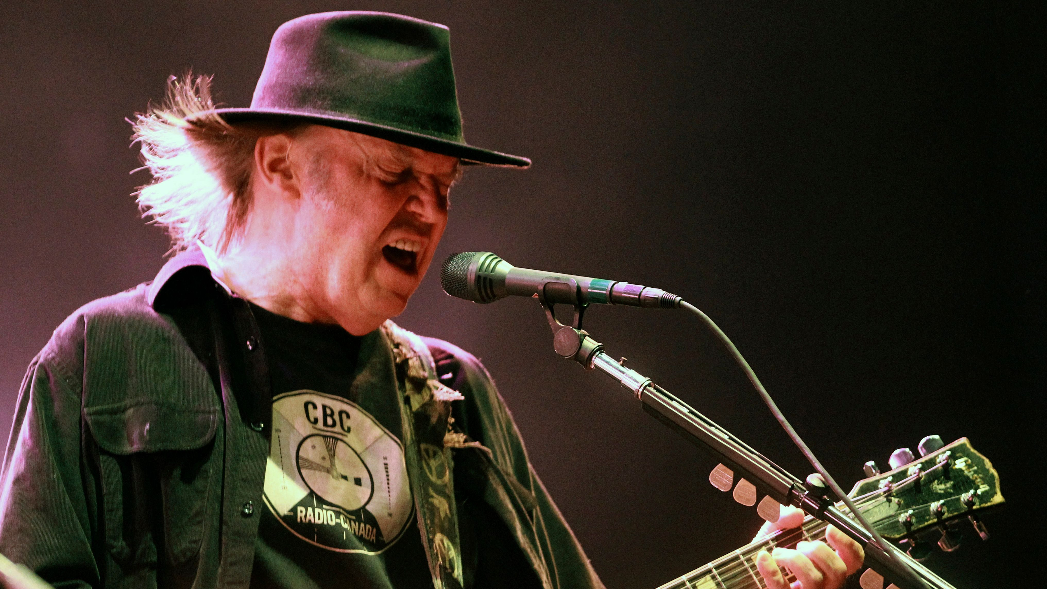 Musician Neil Young performs with his band 'Crazy Horse' during a concert in Biarritz, southwestern France, Thursday, July 18, 2013. (AP Photo/Bob Edme)