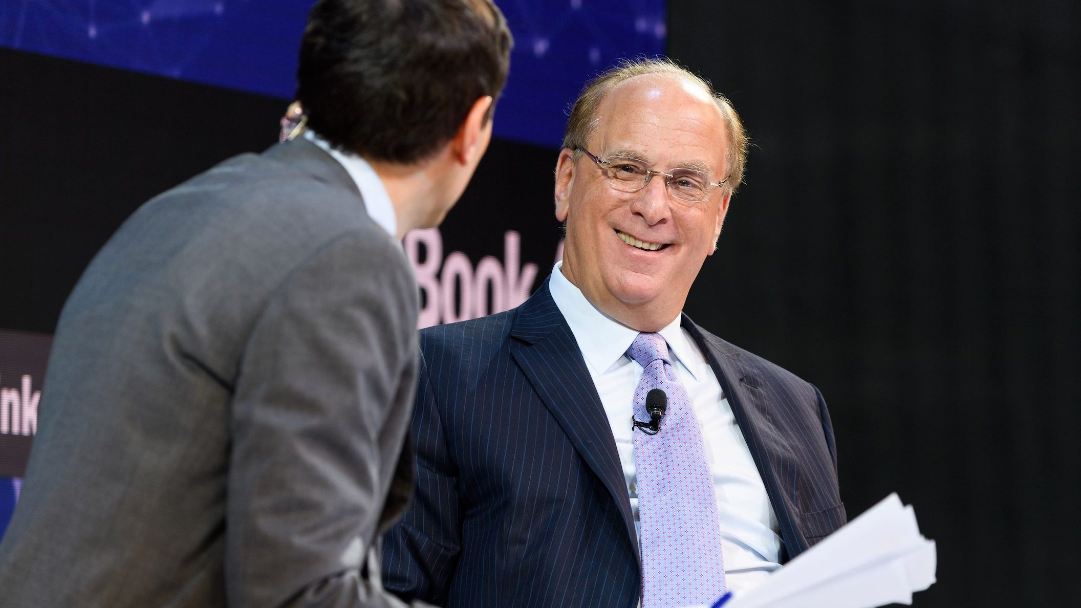 New York Times journalist Andrew Ross Sorkin interviews Larry Fink, CEO of BlackRock at the DealBook Conference, 2018