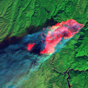 Short-wave infrared (red) captured by Landsat 8 shows the full extent of the actively burning area of the Camp Fire four hours after it started. The red patches are fires that leapfrogged in front of the primary burn front, which was growing at a rate of approximately 5 km per hour.