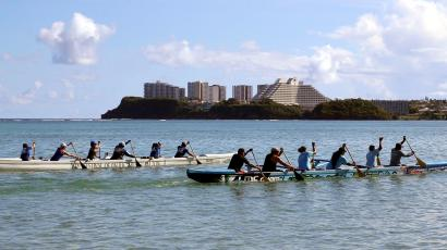 Guam's national rowing team practice on the waters off Tamuning City on the island of Guam, a U.S. Pacific Territory, August 12, 2017.