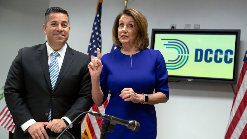 House Democratic Leader Nancy Pelosi of California, center, and Democratic Congressional Campaign Committee Chairman Rep. Ben Ray Lujan, D-N.M., left, meet with reporters on Election Day at the Democratic National Committee headquarters in Washington, Tuesda...</blockquote><div class=