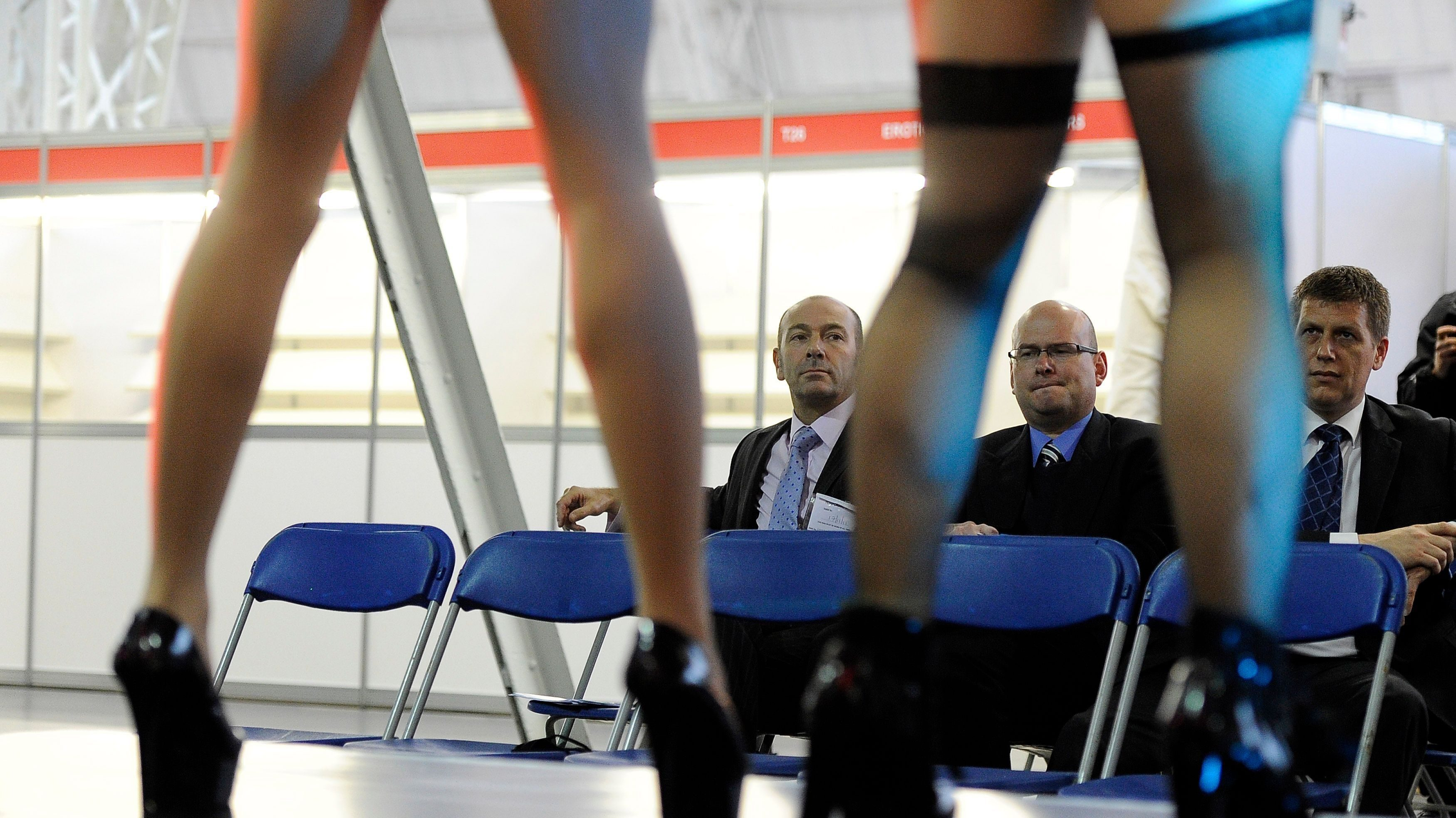 Police and council officials watch to vet dancers before the opening of Erotica 2011, London, November 17. REUTERS/Paul Hackett (SOCIETY ENTERTAINMENT) - LM1E7BH1GDM01