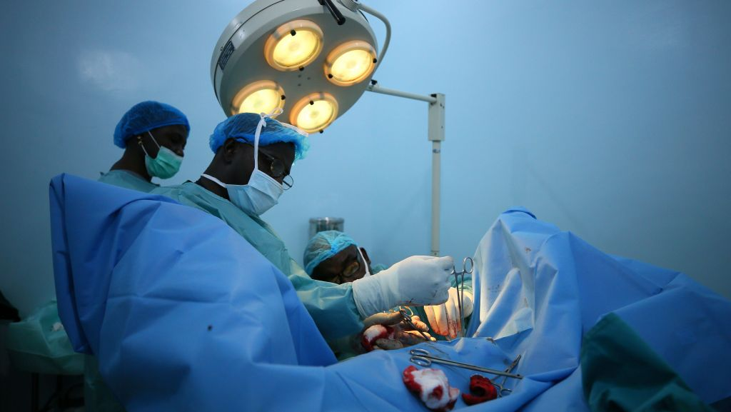 Doctors performing heart surgery.