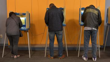Voters fill out their ballots at an early voting polling station in Milwaukee, Wisconsin, U.S. November 4, 2018.