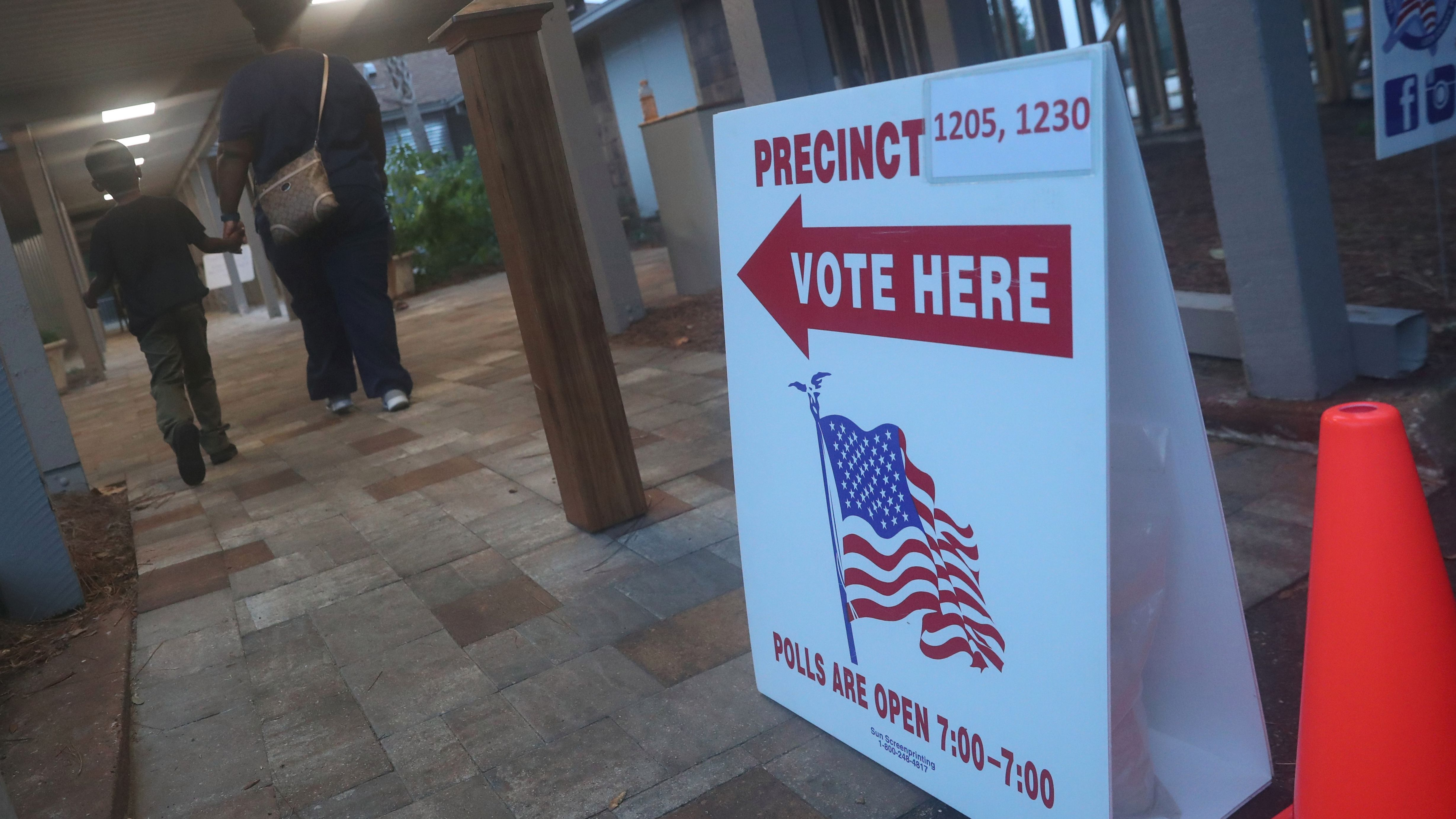 Voters head to a polling station in Tallahassee, Florida, U.S.