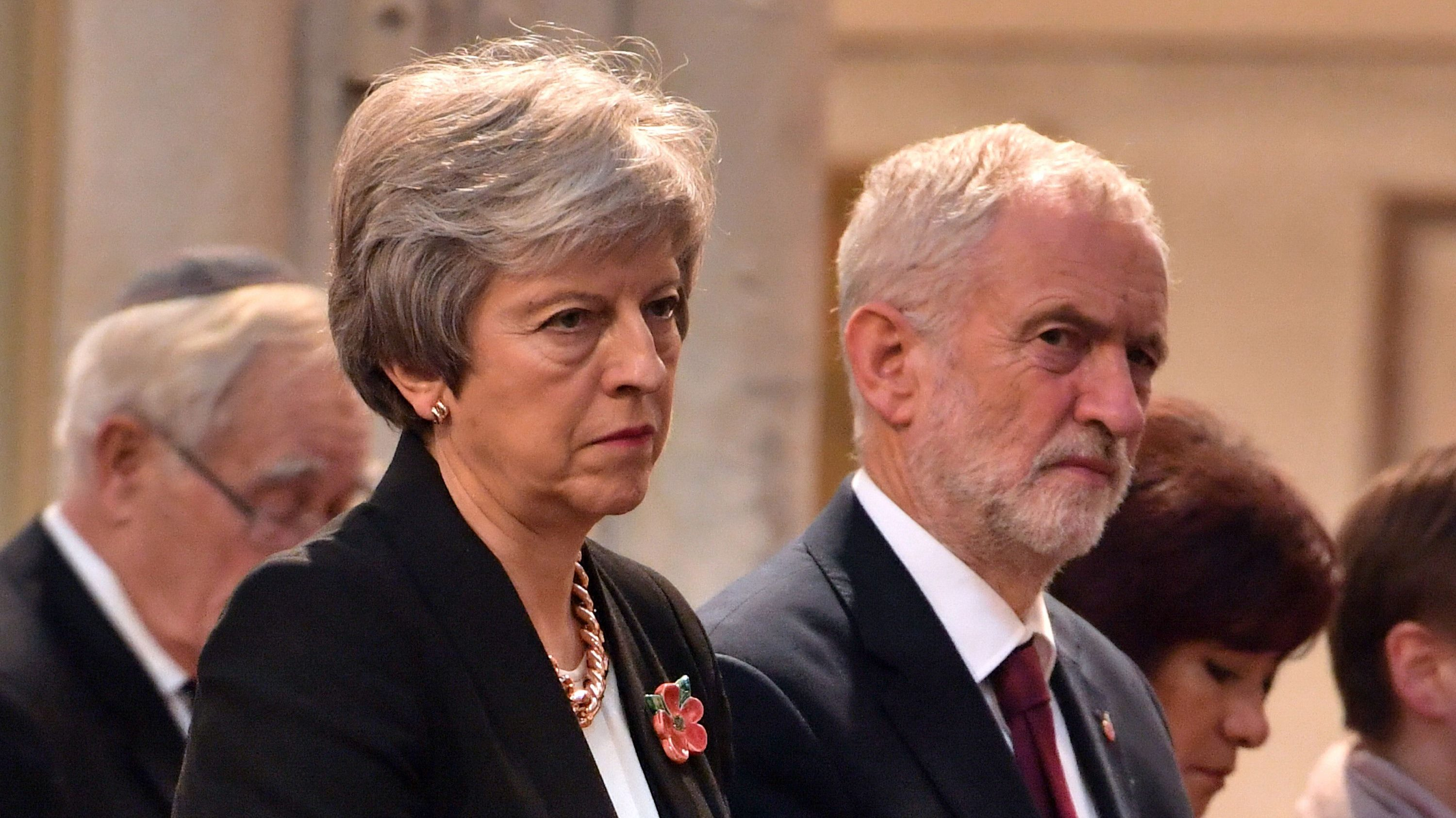 Britain's Prime Minister, Theresa May, and the leader of opposition Labour Party, Jeremy Corbyn attend an Armistice remembrance service at St Margaret's Church in London