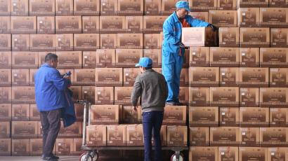 Workers transport boxes of baijiu at a Henan Yangshao Liquor plant in Sanmenxia, Henan province, China November 6, 2018. Picture taken November 6, 2018. REUTERS/Stringer ATTENTION EDITORS - THIS IMAGE WAS PROVIDED BY A THIRD PARTY. CHINA OUT. - RC1C2EAF7490