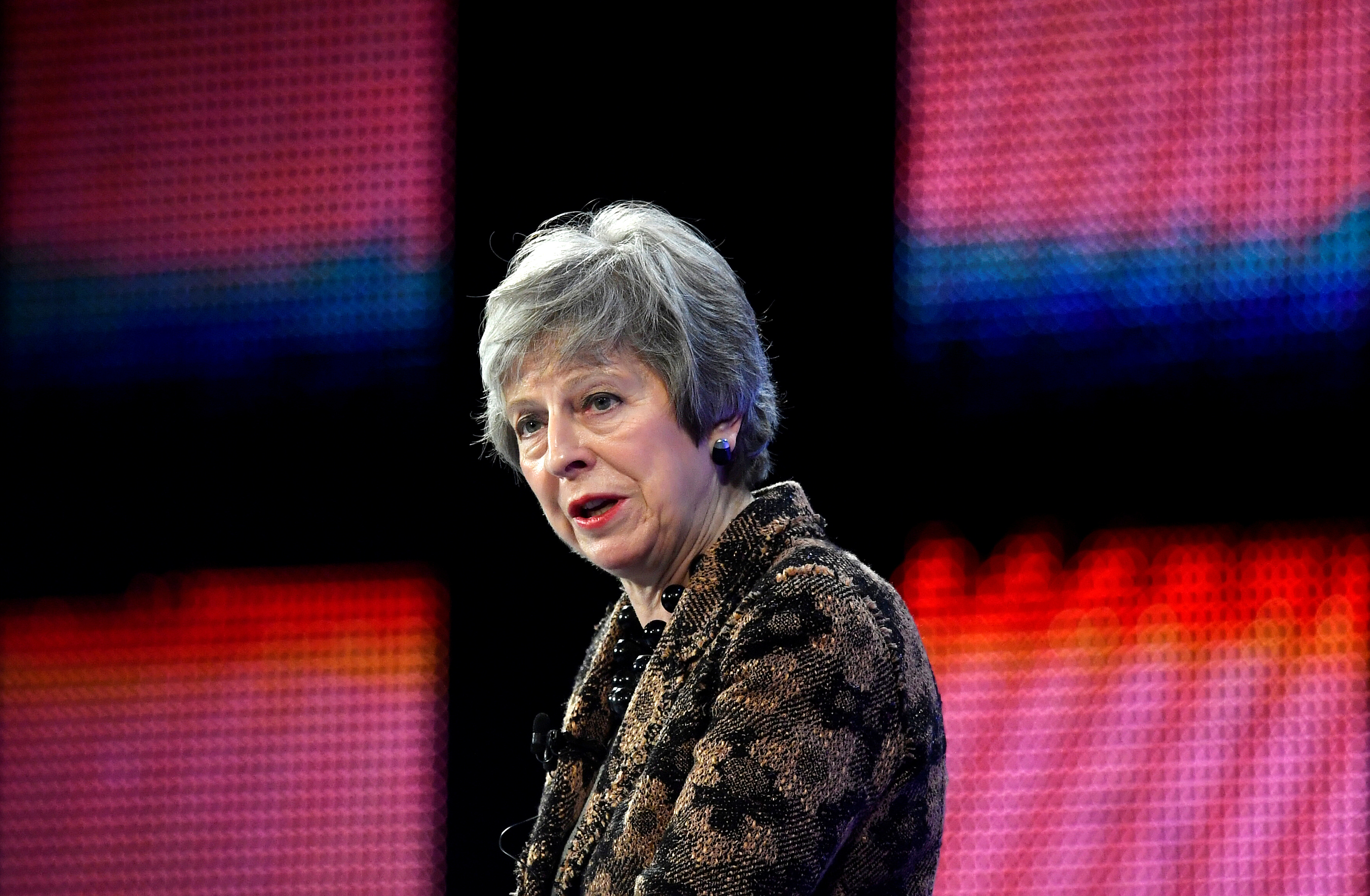 Britain's Prime Minister Theresa May replies to questions after speaking at the Confederation of British Industry's (CBI) annual conference in London