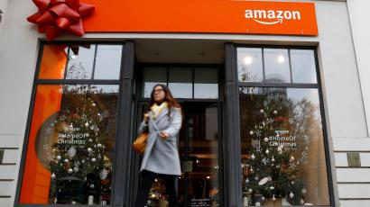 A customer leaves a new Amazon pop-up store for Christmas at Berlin's main shopping street, November 22, 2018.