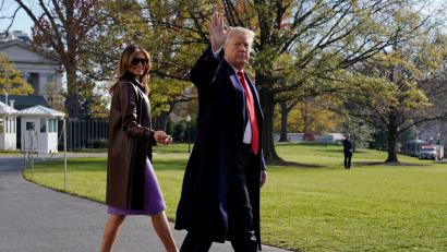 U.S. President Donald Trump walks with first lady Melania Trump as they depart for travel to the G-20 summit in Argentina from the White House in Washington, U.S., November 29, 2018.