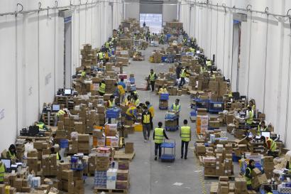 Employees sort boxes and parcels at the logistic centre of a express delivery company, after the Singles Day online shopping festival, in Wuhan