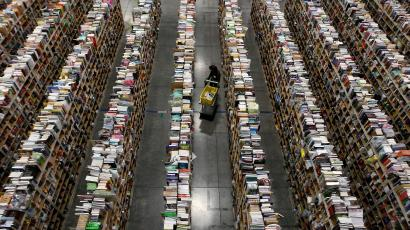 A worker gathers items for delivery from the warehouse floor at Amazon's distribution center in Phoenix, Arizona November 22, 2013. The web-based retailer is preparing for Cyber Monday, which is traditionally the busiest day of the year for online purchases, and falls on December 2 in 2013. REUTERS/Ralph D. Freso (UNITED STATES - Tags: BUSINESS TPX IMAGES OF THE DAY EMPLOYMENT) - GM1E9BN0U6B01
