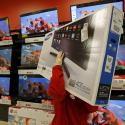 A worker carries a television for a customer who made a purchase during Black Friday Shopping at a Target store in Chicago, Illinois, United States, November 27, 2015. REUTERS/Jim Young - GF20000076543