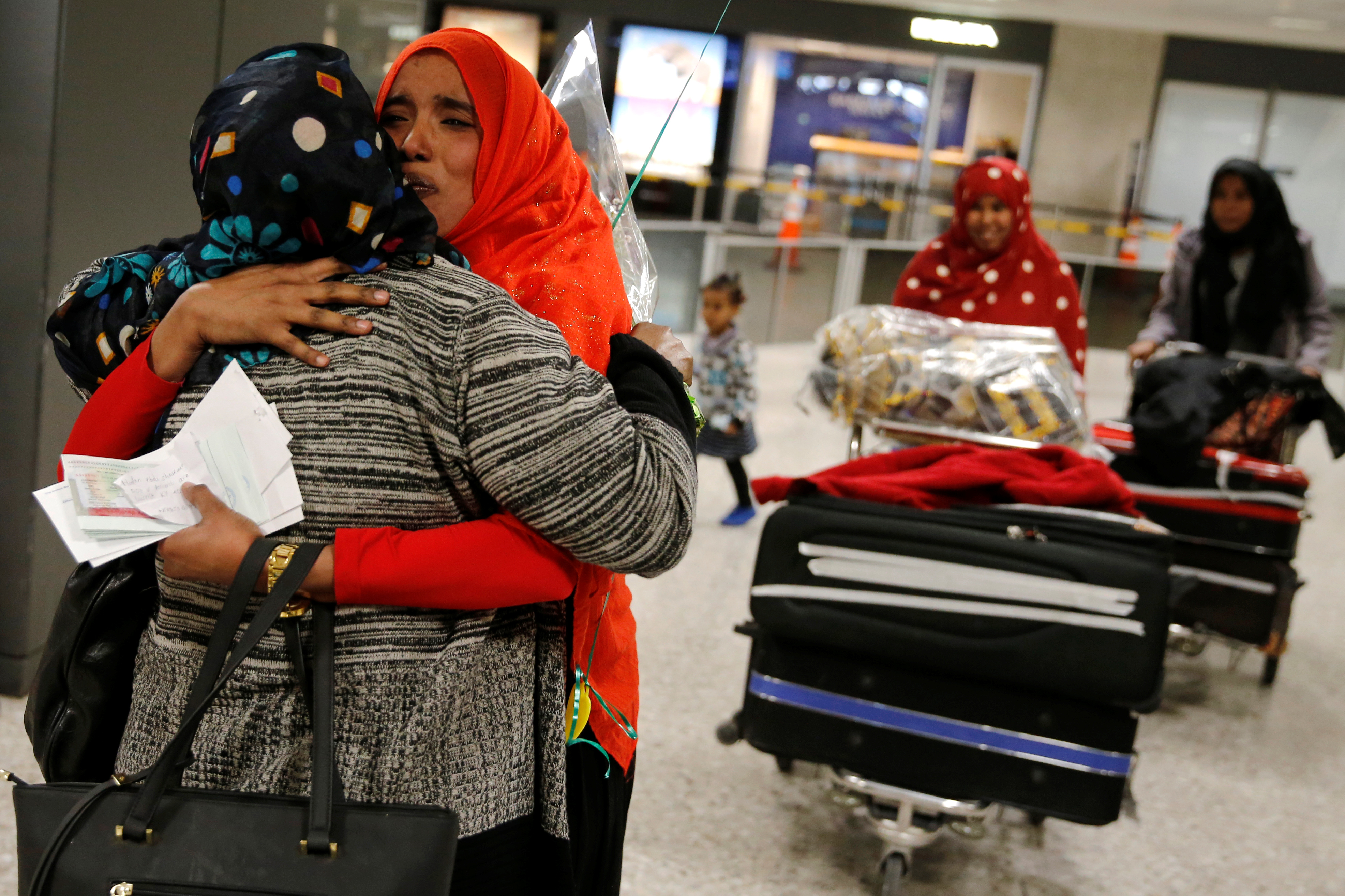 Najmia Abdishakur (2nd L), a Somali national who was delayed entry to the U.S. because of the recent travel ban, is greeted by her mother Zahra Warsma (L) at Washington Dulles International Airport in Chantilly, Virginia, U.S. February 6, 2017.