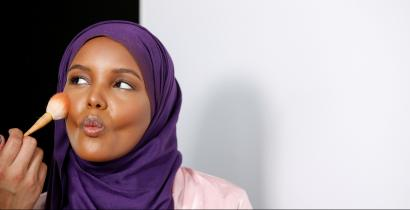 Fashion model and former refugee Halima Aden, who is breaking boundaries as the first hijab wearing model gracing magazine covers and walking in high profile runway shows has her makeup applied during a shoot at a studio in New York City, U.S .August 28, 2017. Photo taken August 28, 2017. REUTERS/Brendan McDermid - RC1F8F423800