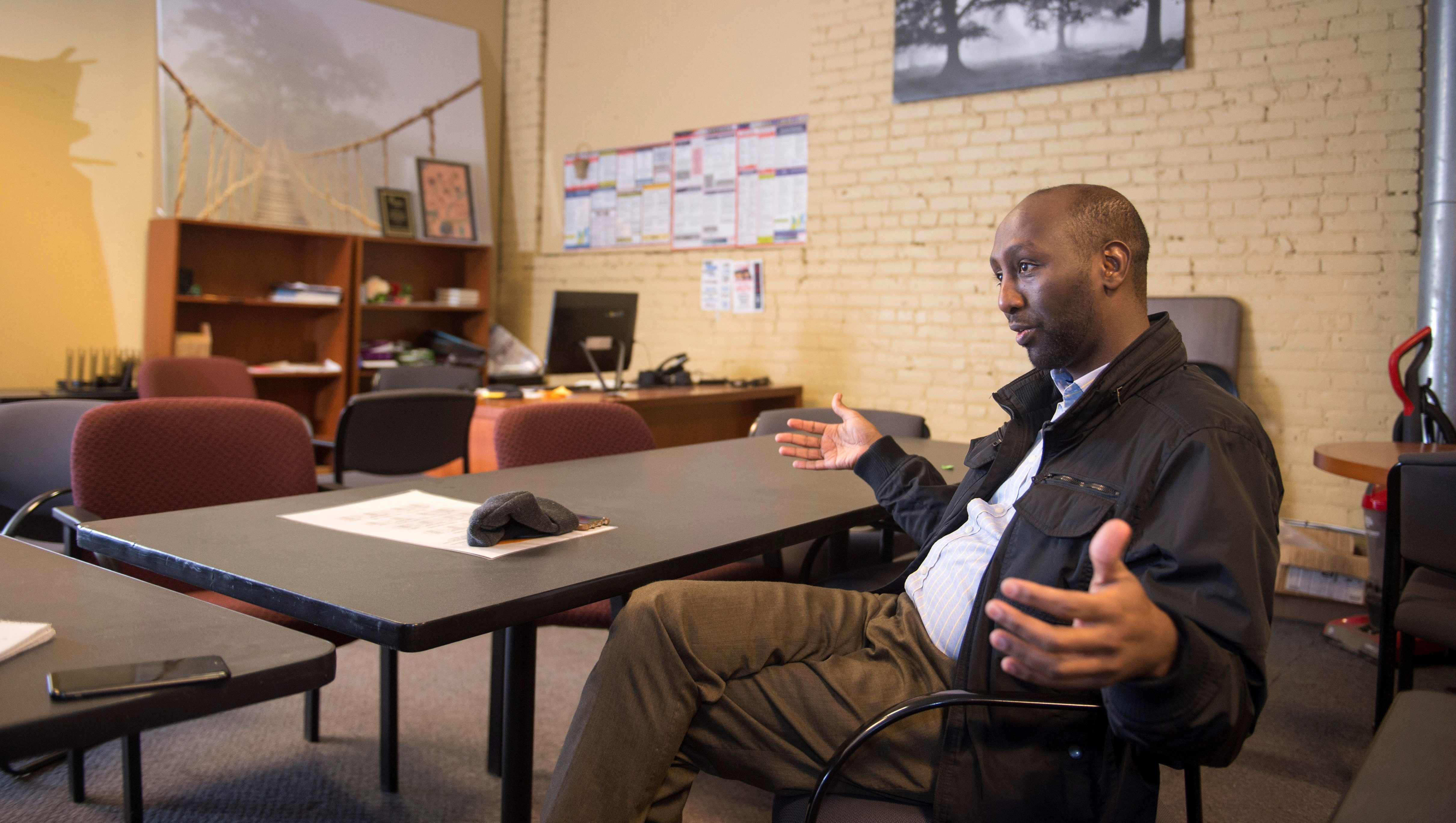 Mohamud Noor, Executive Director of the Confederation of Somali Community in Minnesota talks with a reporter in his office ahead of the NFL's Super Bowl in Minneapolis, Minnesota, U.S. January 19, 2018. Picture taken January 19, 2018.