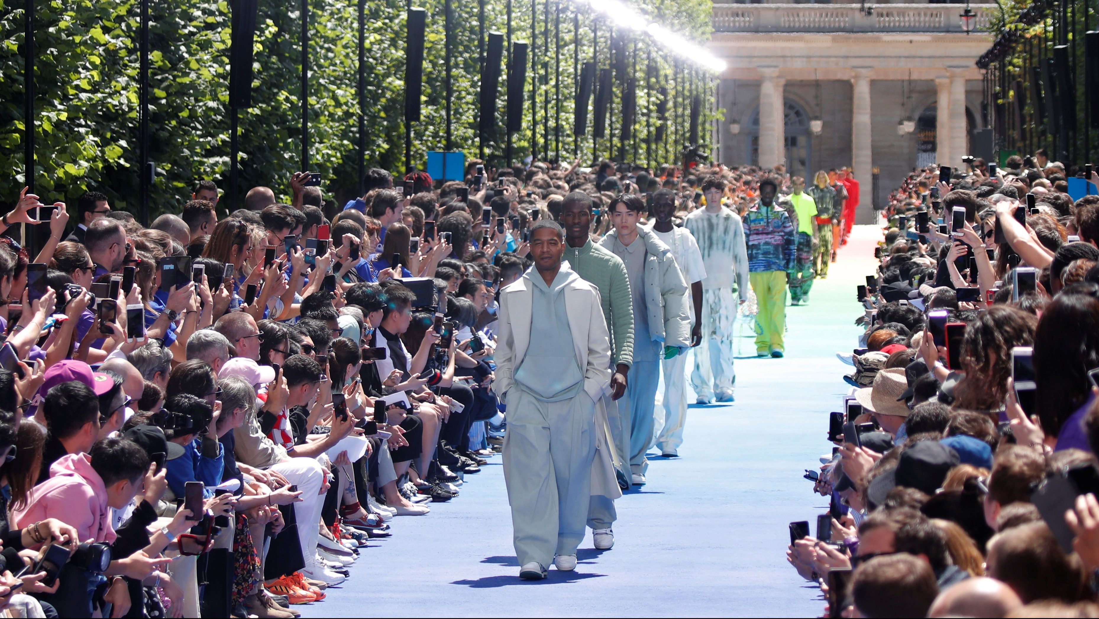 Models present creations by designer Virgil Abloh as part of his Spring/Summer 2019 collection show for Louis Vuitton fashion house during Men's Fashion Week in Paris, France, June 21, 2018. REUTERS/Charles Platiau - RC11A1D8E590