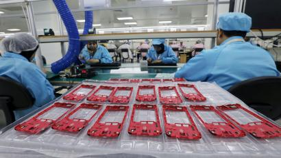 People work on a production line at the mobile phone factory in Assuit, Egypt September 30, 2018. Picture taken September 30, 2018.