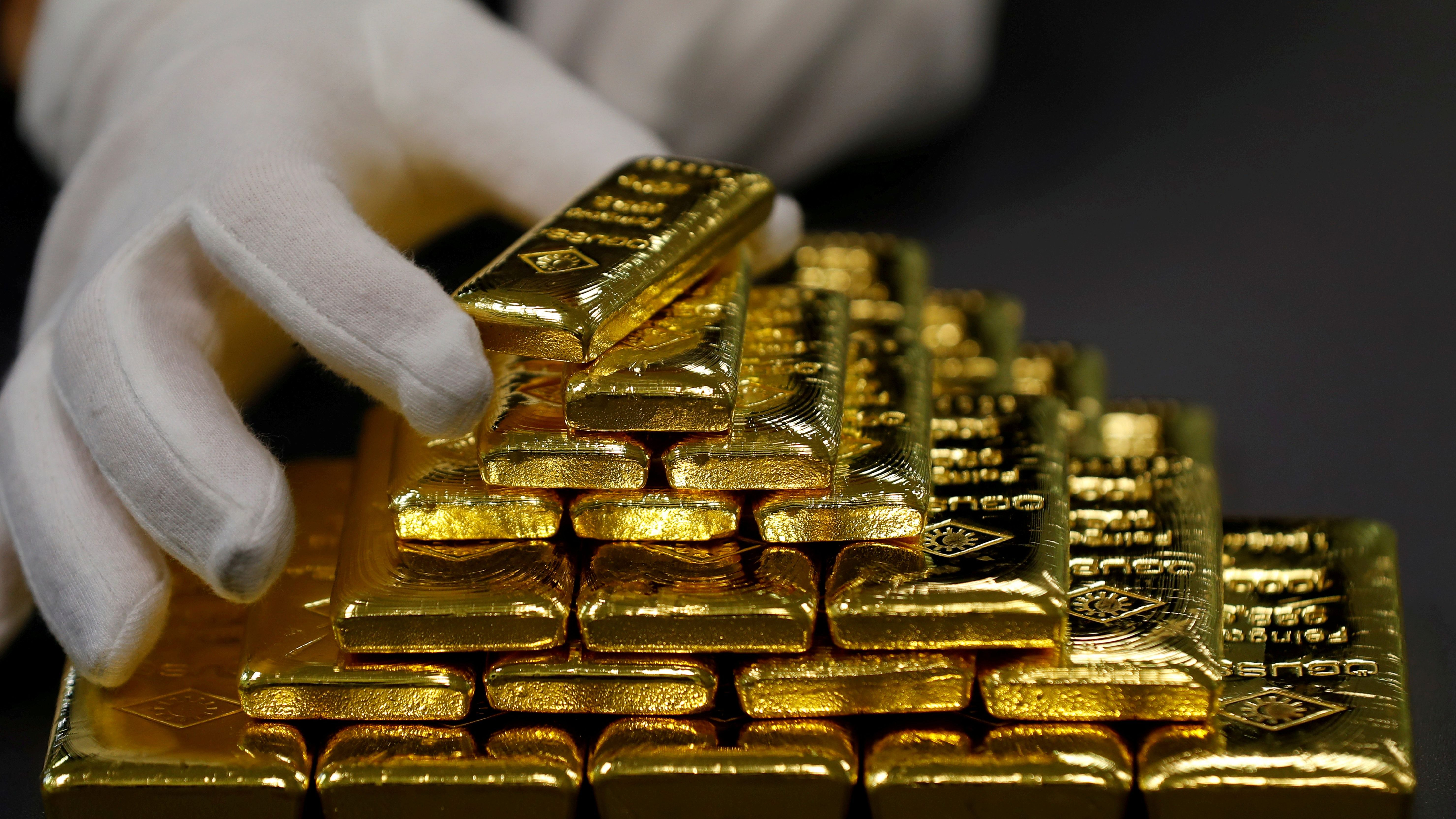 An employee sorts gold bars in the Austrian Gold and Silver Separating Plant 'Oegussa' in Vienna.