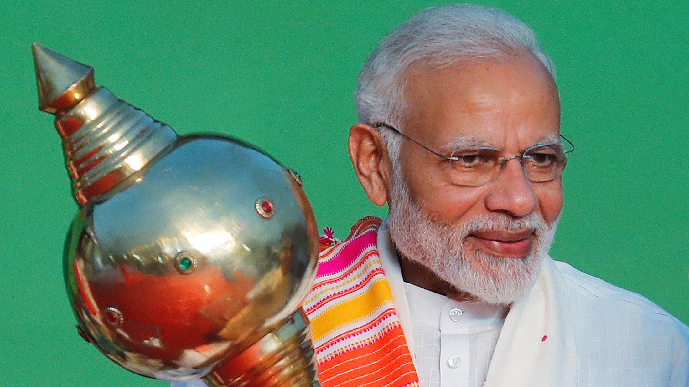 India's Prime Minister Narendra Modi holds a mace during Vijaya Dashmi, or Dussehra, festival celebrations in the old quarter of Delhi