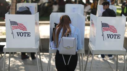 Desteny Martinez, 18, votes for the first time, in the U.S. congressional and gubernatorial midterm elections in Norwalk