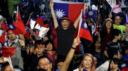 KMT supporters in Kaohsiung celebrate a win in Taiwan's elections.