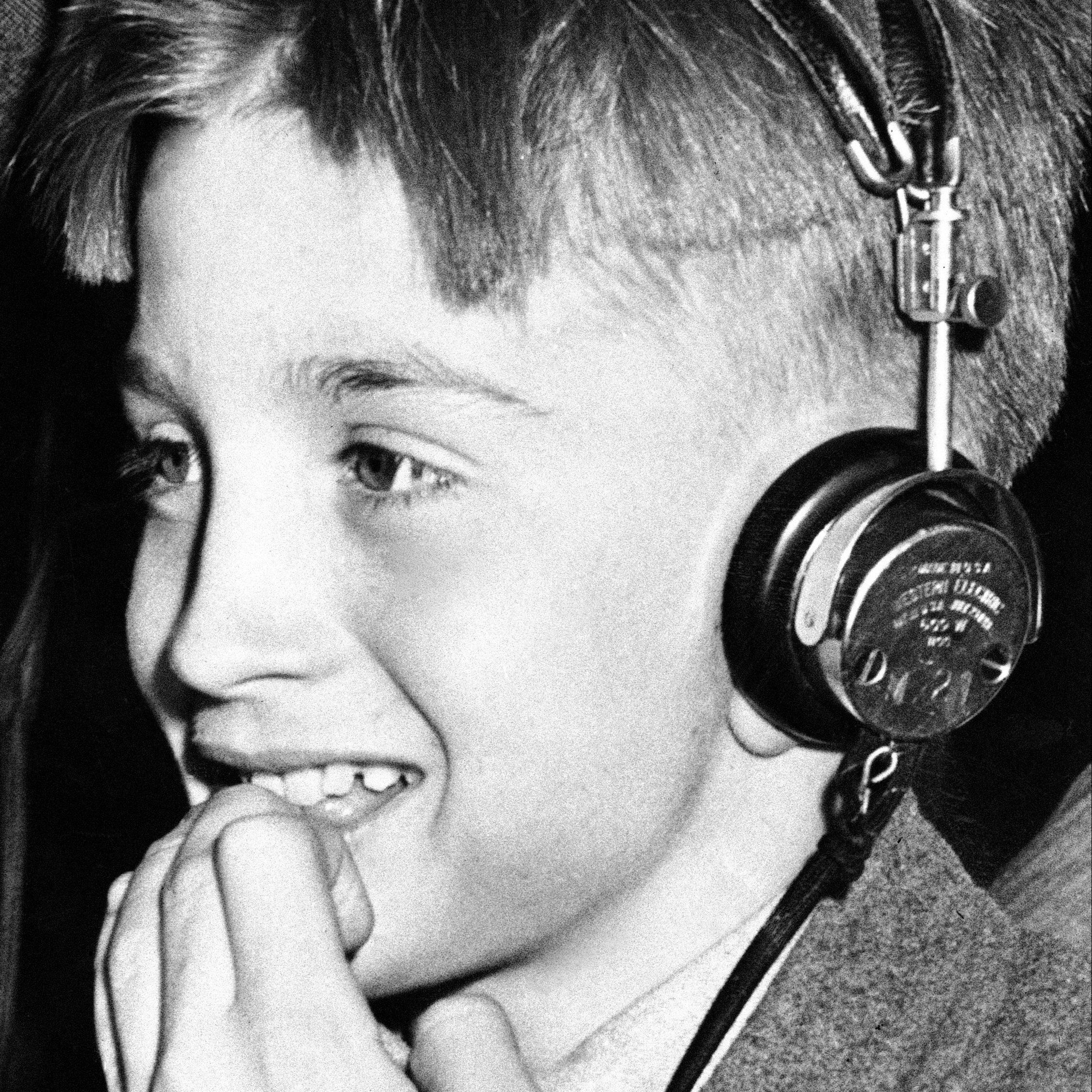A boy wearing headphones.