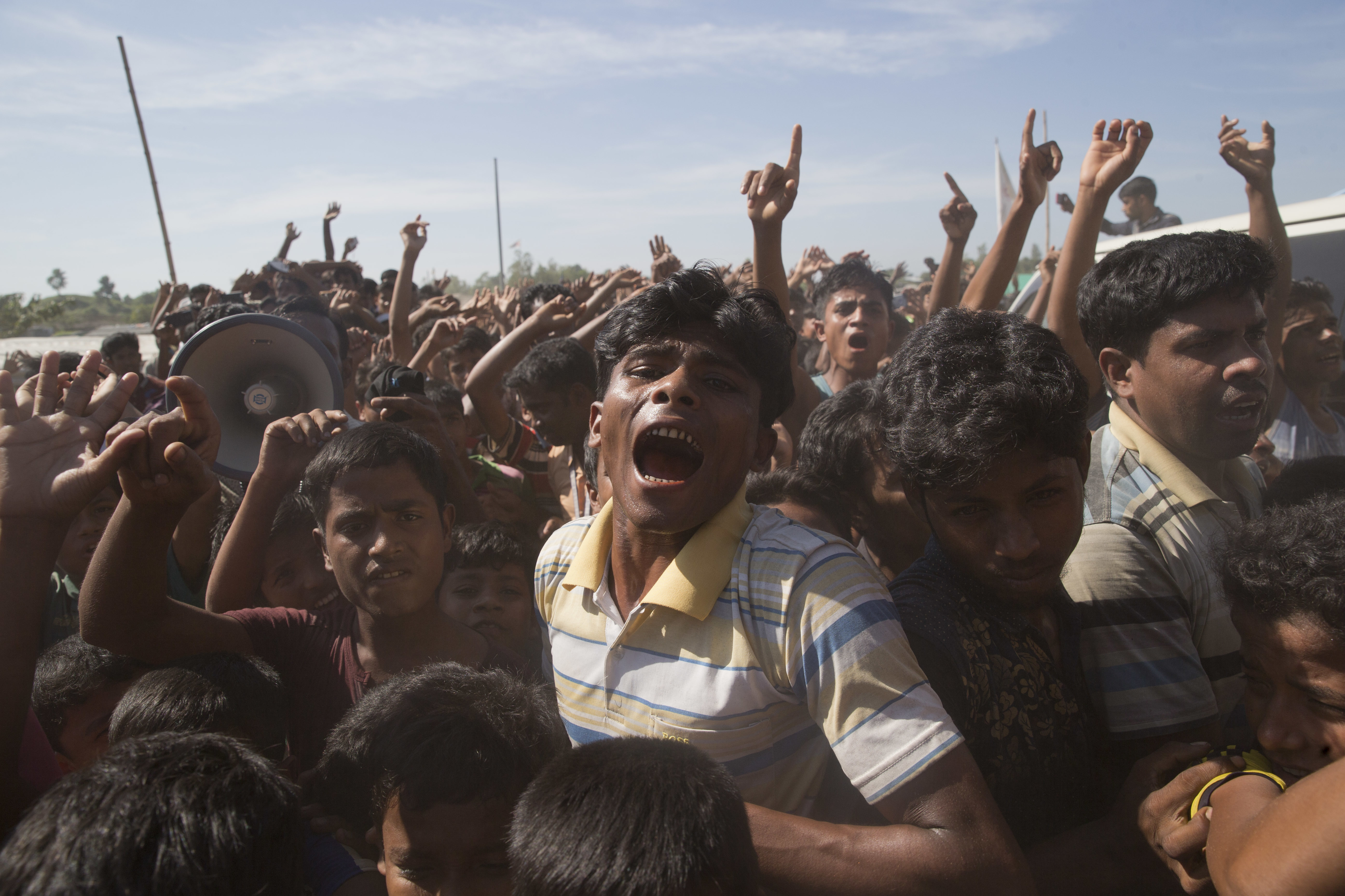 Rohingya refugees shout slogans during a protest against the repatriation process at Unchiprang refugee camp near Cox's Bazar, in Bangladesh, Thursday, Nov. 15, 2018. The head of Bangladesh's refugee commission said plans to begin a voluntary repatriation of Rohingya Muslim refugees to their native Myanmar on Thursday were scrapped after officials were unable to find anyone who wanted to return. (AP Photo/Dar Yasin)