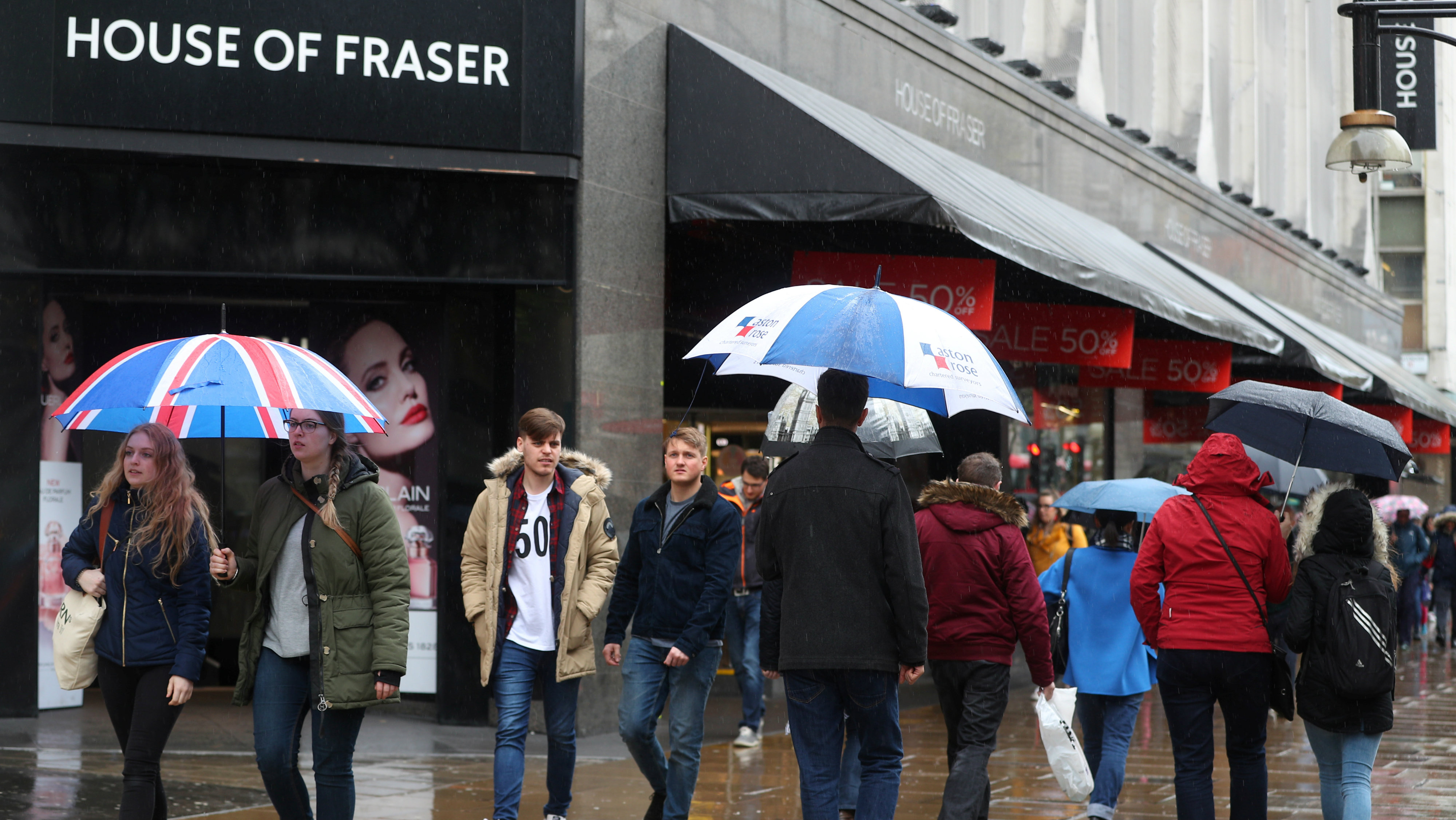 Shoppers walk past House of Fraser on Oxford Street in central London