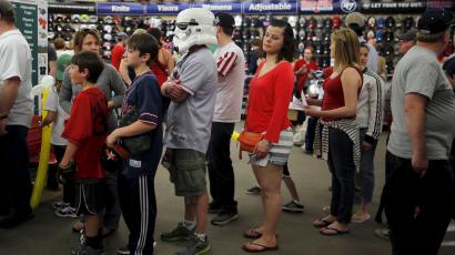 A baseball fan wearing a mask from the Star Wars movies stands in line at a souvenir store