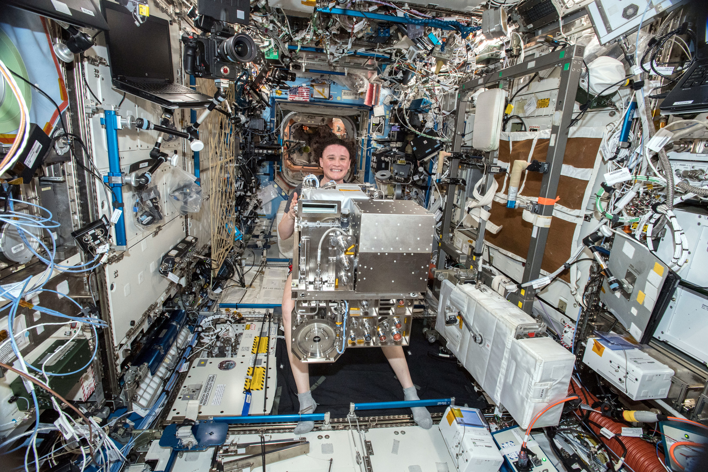 Expedition 57 Flight Engineer Serena Auñón-Chancellor of NASA holds an Air and Water Management Drawer removed from a Life Support Rack inside the U.S. Destiny laboratory during maintenance work aboard the International Space Station.
