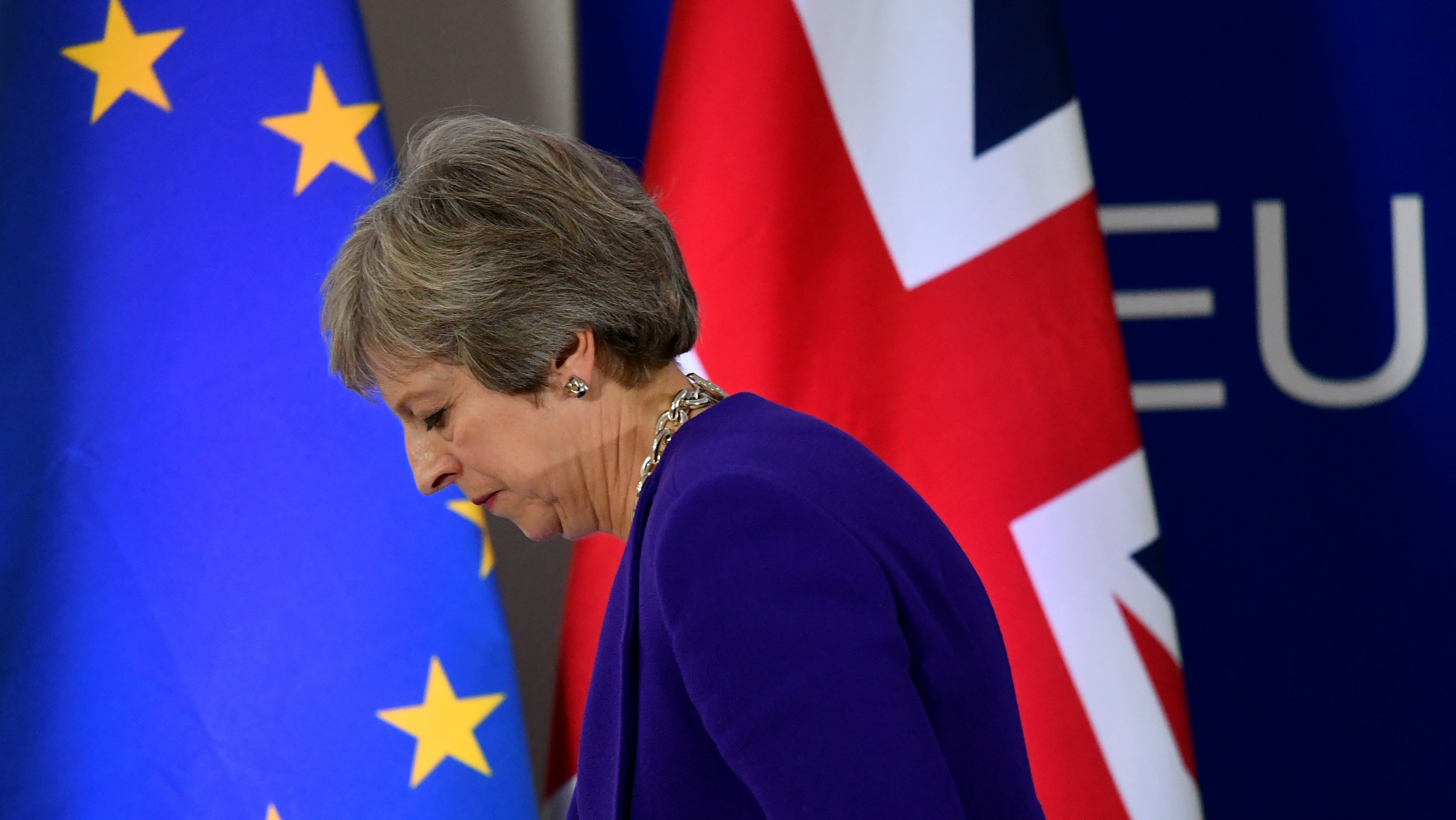 Britain's Prime Minister Theresa May leaves after a news conference at the European Union leaders summit in Brussels, Belgium October 18, 2018