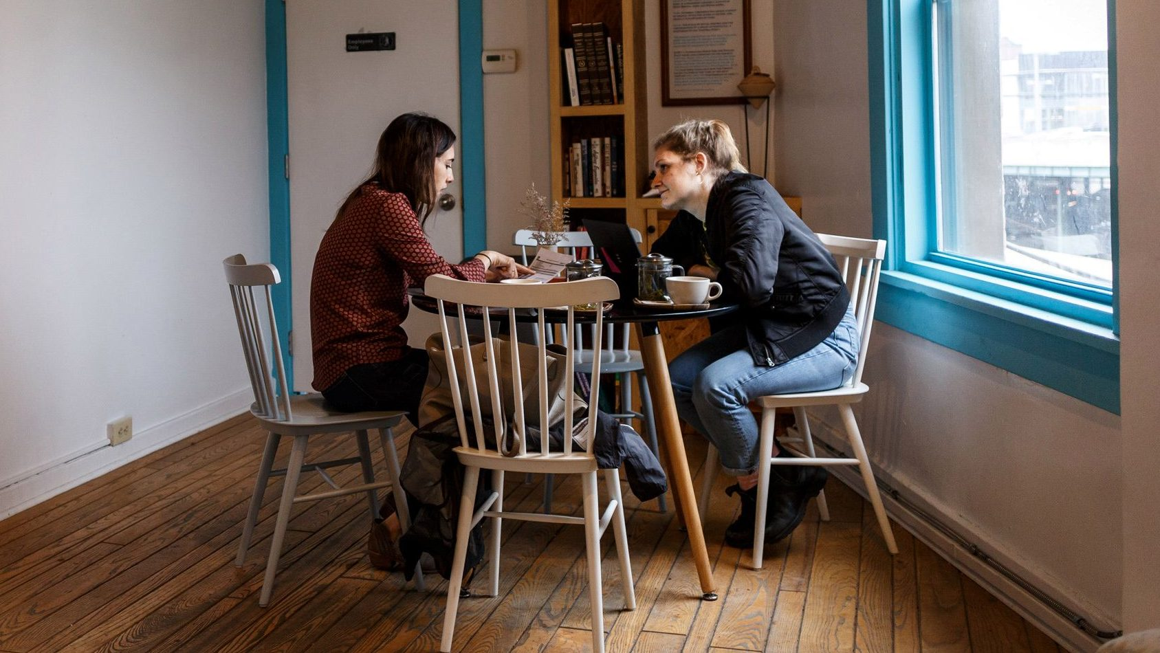 Two young women spend a Friday afternoon at Adda Coffee & Tea House in Pittsburgh