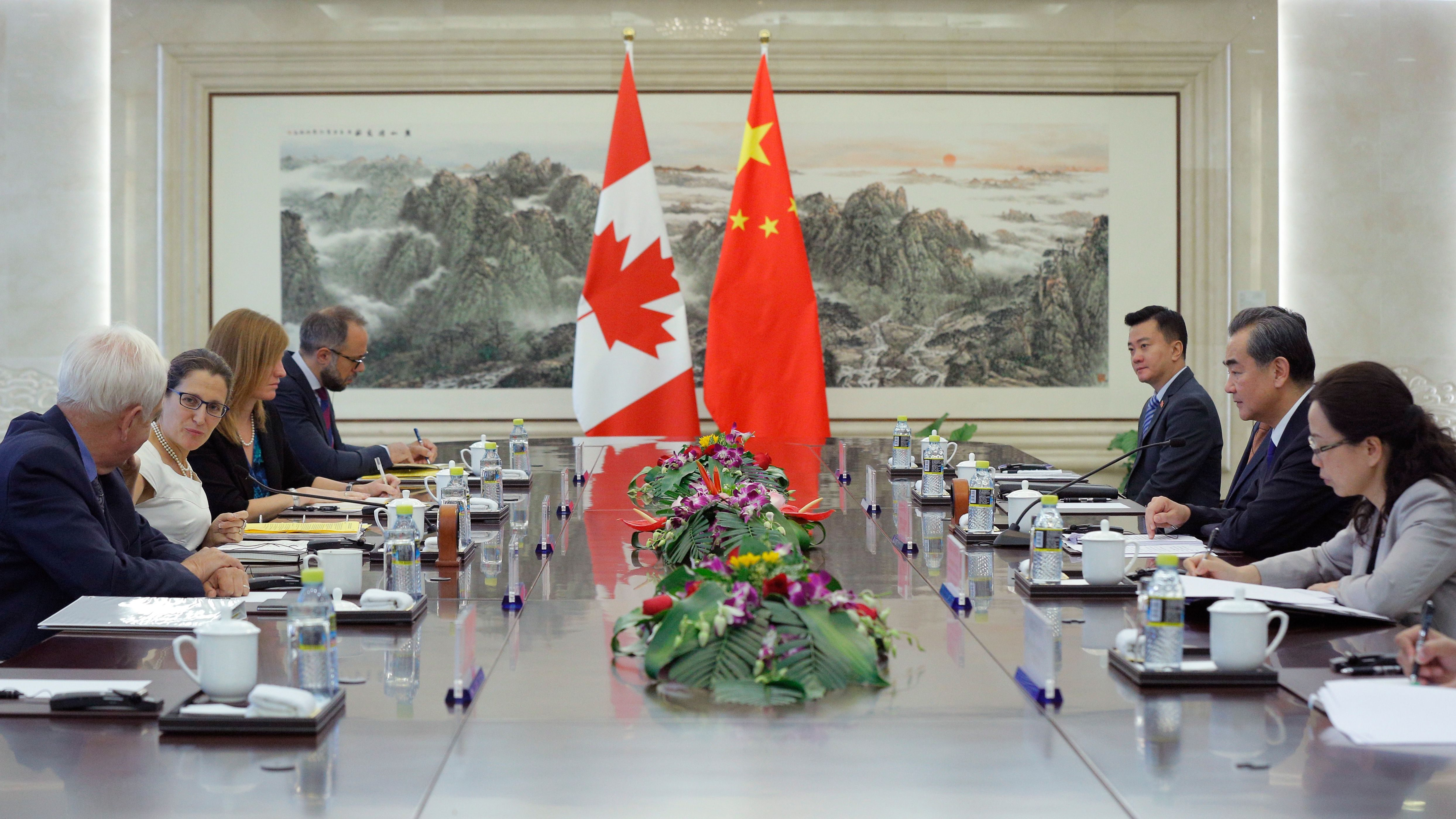 Canada's Foreign Minister Chrystia Freeland, second left, and China's Foreign Minister Wang Yi, second right, hold a meeting at the Ministry of Foreign Affairs in Beijing,