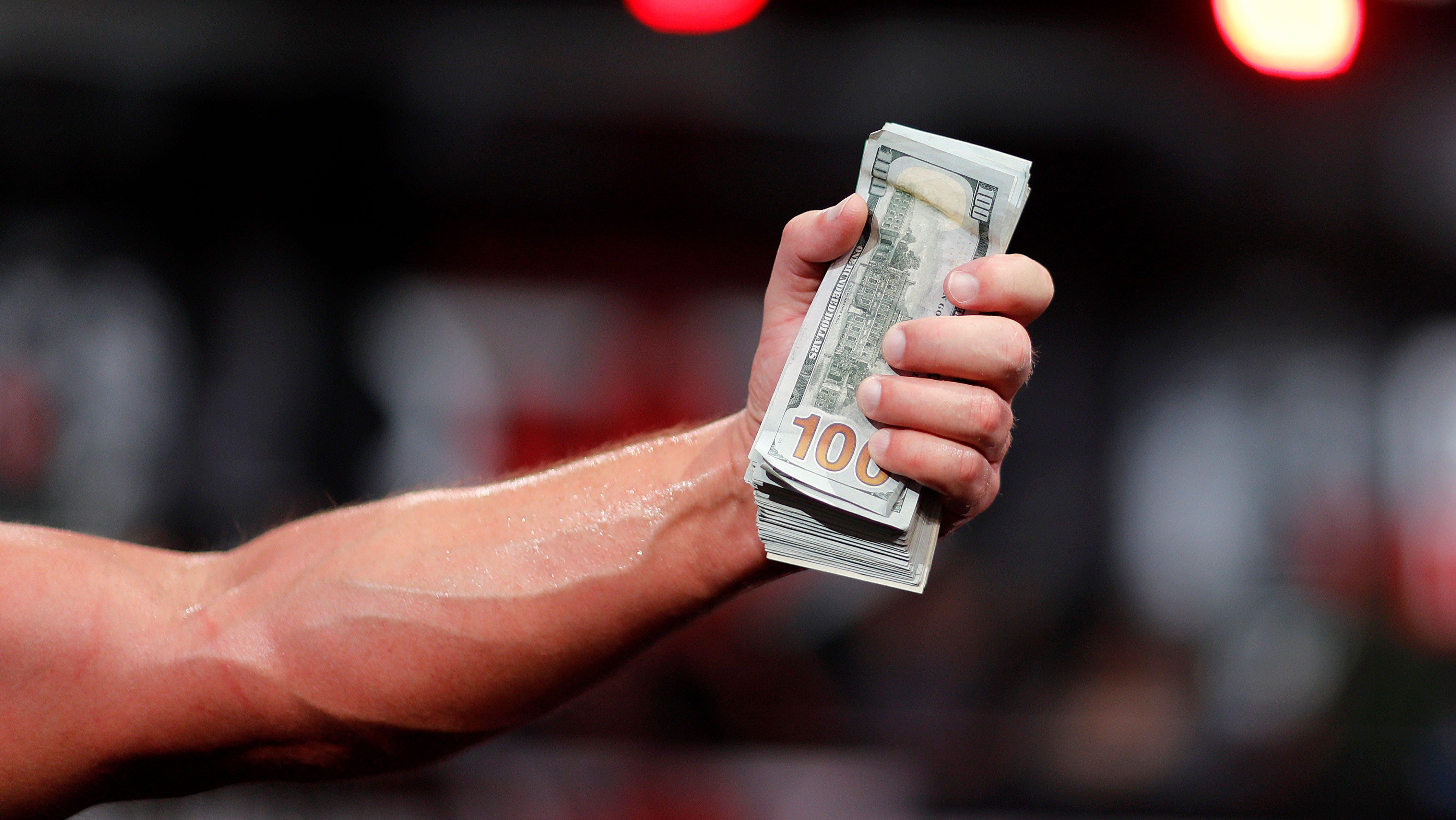 Money in the hand.