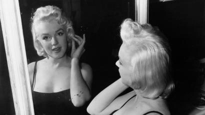 In conference - Actress Marilyn Monroe, film star turned business executive, checks her lines - all curves - in a mirror at the photographic studio of her business partner, Milton Greene, in New York Jan. 28, 1955. A contract wrangle with 20th century-fox threatens to delay Marilyns recently announced plans to do some movie producing on her own. Greene, a commercial photographer, says he is going to be vice president of the newly formed Marilyn Monroe Productions, Inc. (AP Photo)