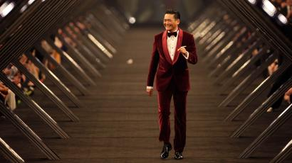 Hong Kong actor Chow Yun-fat smiles as he presents a Hugo Boss creation during the BOSS Black fall/winter 2012 fashion show by Hugo Boss in Beijing, May 18, 2012.