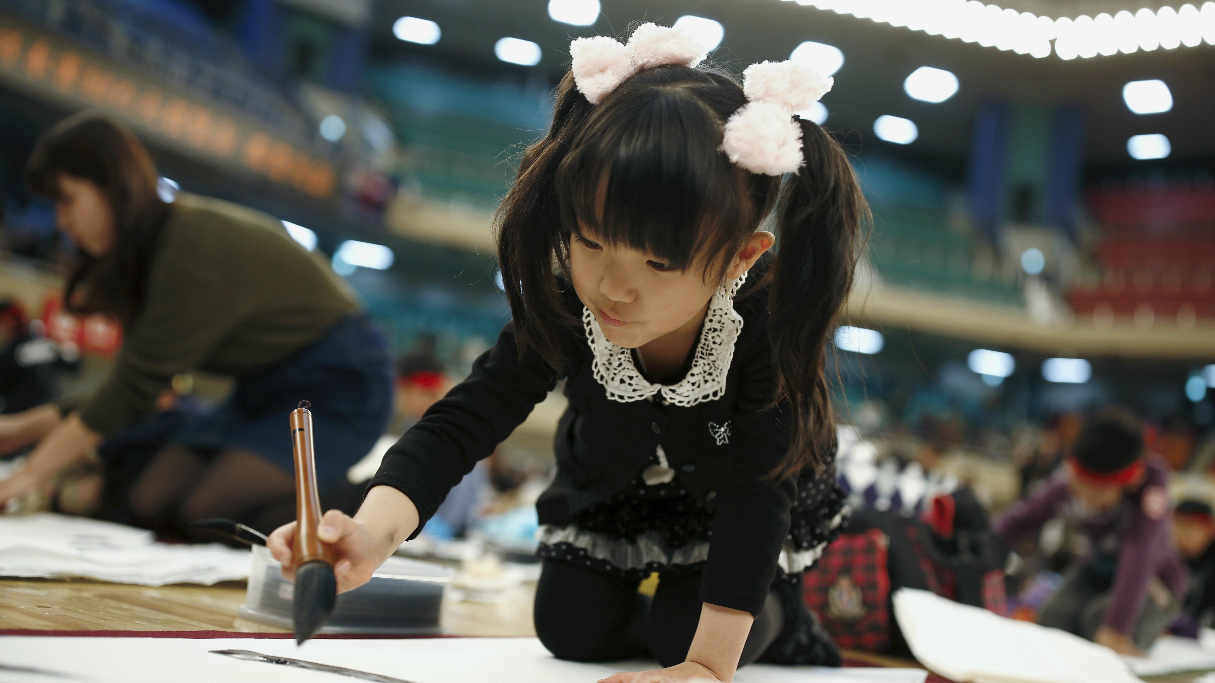 Girl doing calligraphy