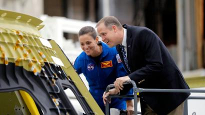 NASA Administrator James Bridenstine, right, and astronaut Nicole Mann look at the Orion Exploration Mission 2 crew capsule, the first one that will fly into space with a crew, at the NASA Michoud Assembly Facility in New Orleans, Monday, Aug. 13, 2018.