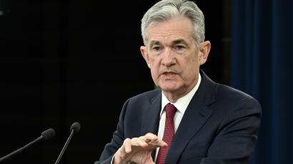 Federal Reserve Chair Jerome Powell at a lectern.