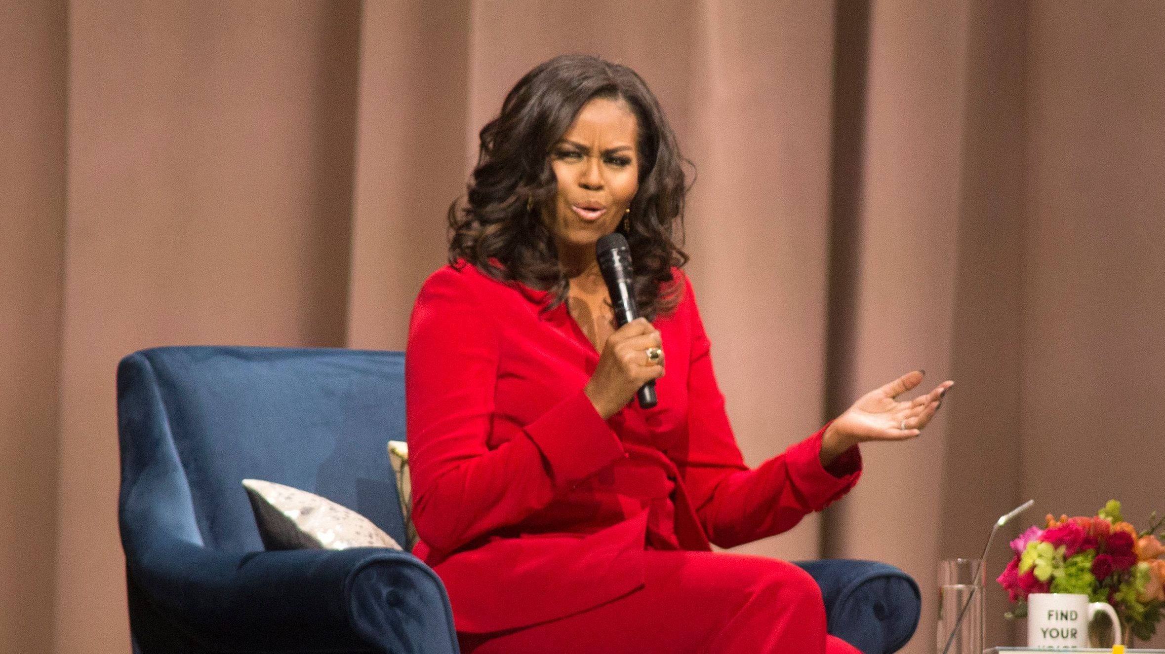 Michelle Obama and Phoebe Robinson on stage